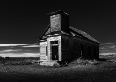 black and white fine art photography of church in ghost town.